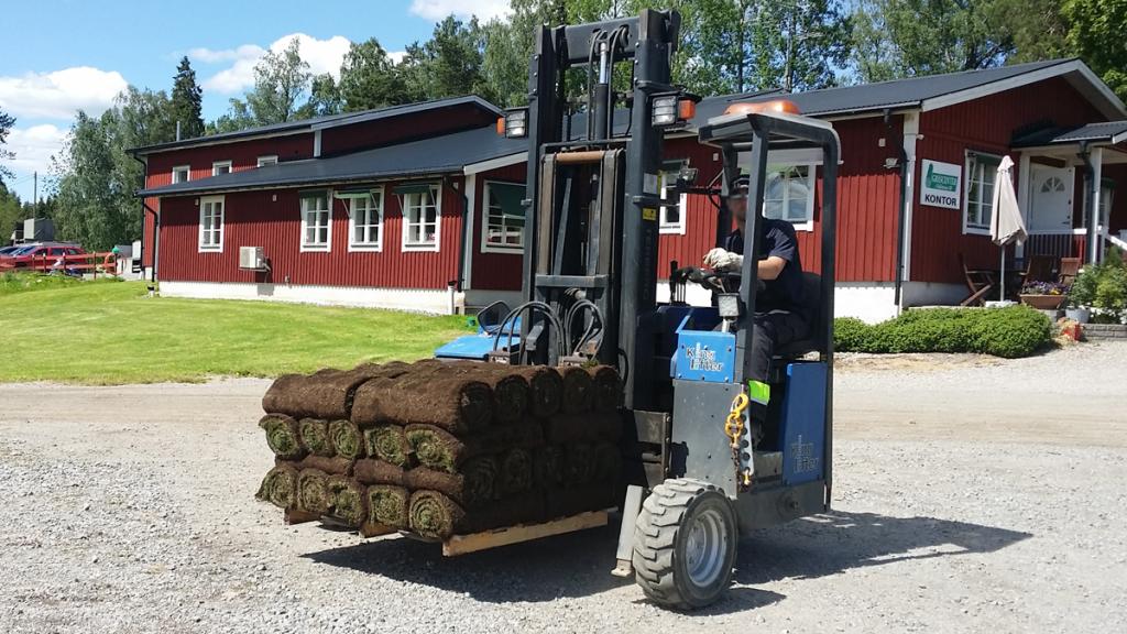 Trucklossning-färdig-gräsma